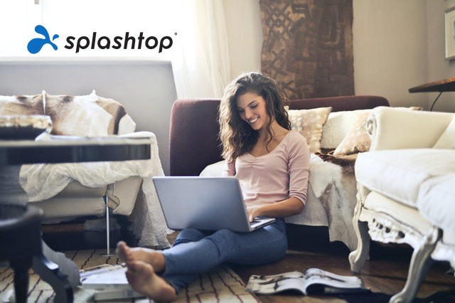 A woman happily working from home with Splashtop